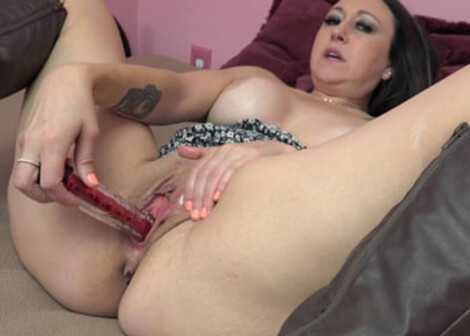Claudia Lewis enjoys herself with a toy